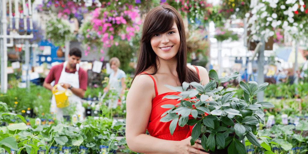 Customer shopping at greenhouse garden center